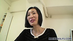 Beautiful Asian lady with a captivating smile has sexual desires that require attention
